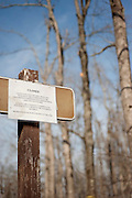 A closed sign hangs at the Alum Cove trail head warning that it is impassable following damage from an ice storm in 2009.