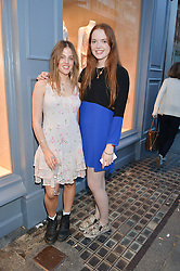 Left to right, ISOBEL SALTER and HELENA HADSLEY-CHAPLIN at a party to celebrate the re-launch of the Ghost Flagship store at 120 King's Road, London on 15th April 2015.