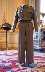"""Embargoed to 2100 Friday May 08 File photo dated 04/07/16 of a pair of Auxiliary Territorial Service overalls and a cap, worn by Queen Elizabeth II, then Princess Elizabeth whilst serving in the wartime ATS, on display at Buckingham Palace in London. As the Queen spoke of the jubilant celebrations which """"some of us experienced first-hand"""", she was no doubt thinking back to her own VE Day adventures."""
