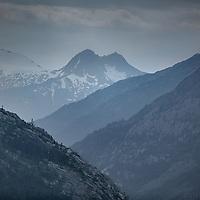 Layers of blue encompass this mountain scene taken along the Skagway to Whitehorse rail journey in Alaska.