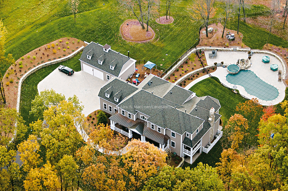 A three-story single-family home requires large amounts of energy relative to its occupants.  Lawn and pool maintenance add to the home's energy comsumption.