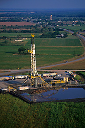 Stock photo of the aerial view of an on-shore rig and work site