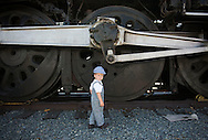 Little conductor Weston Ashland, 2, of Laguna Hills, smiles next to the former Santa Fe #3751 steam locomotive, the oldest operational locomotive of the 484 class in the world, during the 15th-annual Railroad Days at the Fullerton Transportation Center Saturday.