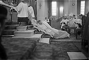 25/07/1962<br /> 07/25/1962<br /> 25 July 1962<br /> Consecration Rev. Dr Grimley S.M.A. as Bishop of Cape Palmas, Liberia at the Pro Cathedral, Dublin. Picture shows Very Rev. Nicholas Grimley S.M.A., prostrating himself on the steps of the altar during the ceremony.