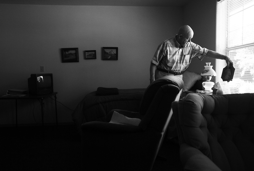 Ivan looks at a wedding portrait while visiting the room of his late wife, Dot, at the retirement home.