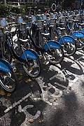 Barclays rental Boris Bikes stationed on dock in Soho Squre, London...Barclays Cycle Hire is a public bicycle sharing scheme that was launched on 30 July 2010 in London, UK. At launch there were 315 bicycle docking stations and 5,000 bicycles available in central London. The scheme is also informally called the Boris Bike scheme after mayor Boris Johnson, who was in office at the time the scheme opened to the public. The project initially covered about 17 square miles (44 square kilometres) of central London - roughly the same area as the 'Zone 1' Travelcard area (covering the whole of the City of London and parts of eight London boroughs)[5]  and will cost an estimated £140 million (more than £20,000 per available bike) over six years. It is expected to pay for itself over time.[6] Barclays' contribution is £25 million.[The bicycles and the docking stations are built in Canada and are based on Bixi, Montreal's bicycle rental system. Fitzrovia, Wells Street docking station being installed. Over 500,000 bicycle trips were made within the first six weeks of the launch of the scheme.
