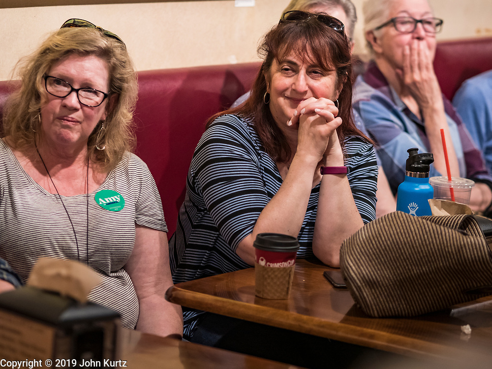 25 MAY 2019 - IOWA FALLS, IOWA: People in Iowa Falls listen to US Senator Amy Klobuchar during a campaign event in Iowa Falls. Sen. Klobuchar is touring Iowa this weekend to support her bid to be the Democratic nominee in 2020 for the US Presidency. Iowa traditionally hosts the the first election event of the presidential election cycle. The Iowa Caucuses will be on Feb. 3, 2020.         PHOTO BY JACK KURTZ