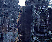 The Temple of Bayonne near Ankor was built by the ruler Jayavarman VII between 1181 and 1200 A.D.  It features excellent bas-relief stone carvings of Buddha faces on the towers of the third level.