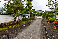 """Mandaraji Temple - Mandaraji is the 72nd sacred spot on the Shikoku Henro pilgrimage, located at the foot of a mountain range consisting of five mountains. From the west, these mountains are Mt. Hiage, Mt. Naka, Mt. Gabaishi, Mt. Fudenoyama and Mt. Koshiki.  This temple has deep ties to the late Heian period monk and poet, Saigyo, who lived nearly 1,000 years ago. On the temple grounds, one can find """"Saigyo's Napping Stone"""", where he is said to have slept, as well as the cherry tree where he hung his hat. There is a monument on the temple grounds commemorating the hospitality of osettai to pilgrims. Behind the main hall is an impressive Japanese garden."""
