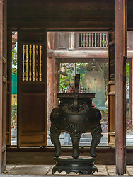 Asia, Vietnam, Hanoi, Temple of Literature, urn with incense and wooden doors