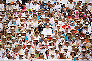 Crowds pack the bleachers at the Guelaguetza Auditorium on Cerro del Fortin in Oaxaca City, Oaxaca, Mexico on July 21, 2008. The Guelaguetza is an annual folk dance festival in Oaxaca - dancers from different regions of the state gather in celebration in Oaxaca City and towns in the Central Valley to perform their regional dances wearing traditional costumes and throw regional specialties as gifts into the crowds.