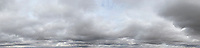 panoramic sky grey clouds with a hint of blue sky in parts
