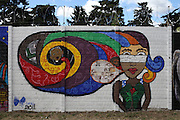 Mural painted by different organizations and artists on the fence surrounding the Historic National Police Archives. On July 5, 2005, the historical archives of the now dissolved National Police were found in an abandoned arms depot in the outskirts of Guatemala City. The discovery of these millions of documents, which were allegedly lost after the 1996 Peace Accords, provide important evidence in the search for the thousands of people who were detained and subsequently disappeared by State security forces during the internal armed conflict (1960-1996). Guatemala City, Guatemala. December 13, 2011.
