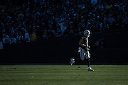 Oakland Raiders quarterback Derek Carr (4) runs off the field during the first quarter against the Indianapolis Colts at Oakland Coliseum in Oakland, Calif., on December 24, 2016. (Stan Olszewski/Special to S.F. Examiner)