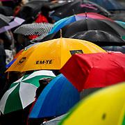 NLD/Amsterdam/20100807 - Boten tijdens de Canal Parade 2010 door de Amsterdamse grachten. De jaarlijkse boottocht sluit traditiegetrouw de Gay Pride af. Thema van de botenparade was dit jaar Celebrate, paraplu'en tijdens de regen van de toeschouwers
