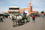 Mosque and caleche Place Jema al-Fna, Marrakech, Morocco, north Africa