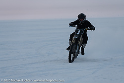 Photographer Aleksei Kalabin of Moscow having fun in the snow on ha friends bike during the Baikal Mile Ice Speed Festival. Maksimiha, Siberia, Russia. Saturday, February 29, 2020. Photography ©2020 Michael Lichter.