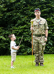The Princess Royal, Princess Anne attended the final rehearsal of the Royal Edinburgh Military Tattoo at Redford Barracks in Edinburgh.<br /> <br /> Pictured: 3 year old Lucais James Galliano looks up to Officer Cadet Drum Major Richard Tidy