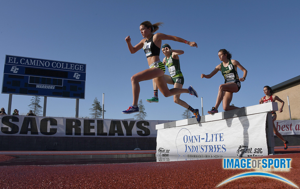 Apr 13, 2017; Torrance, CA, USA; Emma Neigel (Denver Track Club), Jenna Thurman (Adams State),  and Laura Yarrow (Colorado State) race over the water jump in a women's steeplechase heat during the 58th Mt. San Antonio College Relays at El Camino College.
