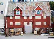 Old corrugated iron warehouse waterside building, Bronnoy, Bronnoysund, Nordland, Norway