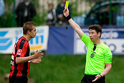 Ivan Graf of Primorje and referee Vojko Gorican with yellow card at football match between NK Primorje Ajdovscina and NK Triglav Gorenjska of Second Slovenian football league, on May 16, 2010 in Vipava, Slovenia. Primorje placed first in 2.SNL and qualified for  PrvaLiga in season 2010/2011. (Photo by Urban Urbanc / Sportida)