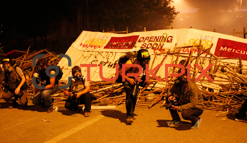 """Protestors clash with Turkish riot policemen on the way to Taksim Square in Istanbul on June 5, 2013, as part of ongoing protests against the ruling party, police brutality, and the destruction of Taksim park for a development project. Turkey's Islamic-rooted government apologised today to wounded protestors and said it had """"learnt its lesson"""" after days of mass street demonstrations that have posed the biggest challenge to Prime Minister Recep Tayyip Erdogan's decade in office. Turkish police had on June 1 begun pulling out of Istanbul's iconic Taksim Square, after a second day of violent clashes between protesters and police over a controversial development project. Conflicts are increasing with each passing day refreshed. Photo by AYKUT AKICI/TURKPIX"""