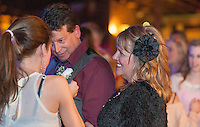 Libby Davies attached the boutonniere to her dad, William Davies with her fiance Sharon Vaillancourt just prior to their wedding nuptials at Pitman's Freight Room on Friday evening.  (Karen Bobotas/for the Laconia Daily Sun)