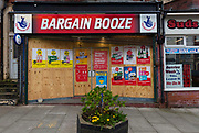 Bargain Booze shop with destroyed windows still in business on 21st April 2021 in Blackpool, Lancashire, United Kingdom. Blackpool is a large town and seaside resort in the county of Lancashire on the north west coast of England. Blackpool was once a booming resort with it's famous promenade which now, despite having a somewhat shabby appearance, still continues to attract millions of visitors each year. During the coronavirus pandemic however, Blackpool has struggled, with empty streets and closed down businesses creating an atmosphere more like a ghost town.