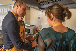 The Duke Cambridge helps to prepare soup and bread during a visit to Centrepoint in Barnsley.