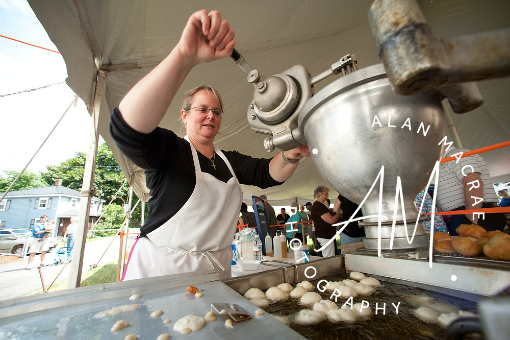 """Presbytera, """"pastor's wife"""", Kelly Papps prepares Loukomathes, a Greek style of fried dough, during the annual Greek Festival at the Taxiarchai Greek Orthodox Church in Laconia on Saturday, July 25, 2009.  (Alan MacRae/for the Citizen)"""