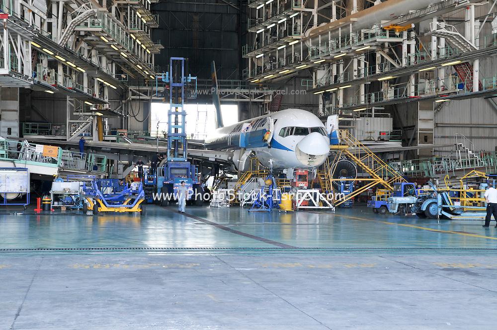 Israel, Ben-Gurion international Airport maintenance working on a Sun D'or Boeing 757 in a maintenance hanger