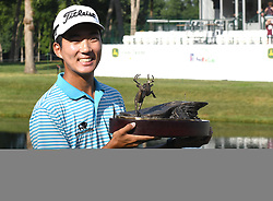 July 15, 2018 - Silvis, Illinois, U.S. - SILVIS, IL - JULY 15:  Michael Kim holds the championship trophy he won during the  John Deere Classic on July 15, 2018, at TPC Deere Run, Silvis, IL.  (Photo by Keith Gillett/Icon Sportswire) (Credit Image: © Keith Gillett/Icon SMI via ZUMA Press)