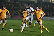 John Akinde of Barnet © is challenged by Mark Randall of Newport county ®. EFL Skybet football league two match, Newport county v Barnet at Rodney Parade in Newport, South Wales on Tuesday 25th October 2016.<br /> pic by Andrew Orchard, Andrew Orchard sports photography.