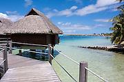 Overwater bungalows on stilts at a resort hotel, Bora Bora, French Polynesia