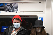 As Londoners await the imminent second coronavirus lockdown people wearing face masks on the underground, where face coverings are compulsory, before a month-long total lockdown in the UK on 3rd November 2020 in London, United Kingdom. The three tier system in the UK has not worked sufficiently, to suppress the virus, and there have have been calls by politicians for a 'circuit breaker' complete lockdown to be announced to help the growing spread of the Covid-19.