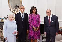 Queen Elizabeth II and the Duke of Edinburgh stand with the President and First Lady of the United States Barack Obama and his wife Michelle (both centre), in the Oak room at Windsor Castle ahead of a private lunch hosted by the Queen.