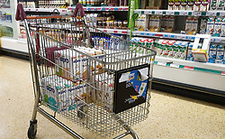 © Licensed to London News Pictures. 07/10/2021. London, UK. A shopper trolley with three full cases of Alpro unsweetened Almond milk in Sainsbury's, north London. The Government and retailers warn that food shortages could continue until Christmas due to labour shortages following Brexit. Photo credit: Dinendra Haria/LNP