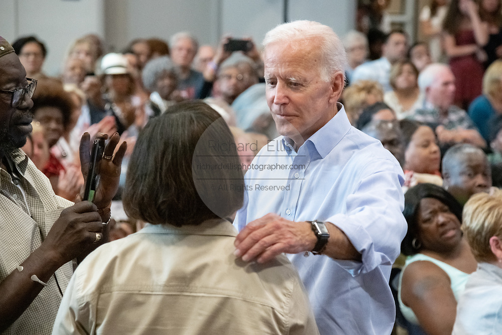 Former Vice President Joe Biden comforts Felicia Sanders, during a town hall meeting at the International Longshoreman's Association Hall July 7, 2019 in Charleston, South Carolina.  Felicia Sanders was a surviver of the Emanuel AME Church shooting in 2015 where nine of her fellow worshippers were murdered by a white supremacist.
