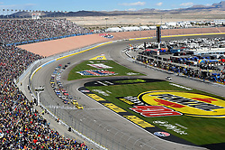 March 4, 2018 - Las Vegas, NV, U.S. - LAS VEGAS, NV - MARCH 04: Joey Logano (22) Team Penske Pennzoil Ford Fusion, Kyle Busch (18) Joe Gibbs Racing (JGR) Toyota Camry and Ryan Blaney (12) Team Penske Ford Fusion lead the field across the starting line for a restart during the Monster Energy NASCAR Cup Series Pennzoil 400 on March 04, 2018 at Las Vegas Motor Speedway in Las Vegas, NV. (Photo by Chris Williams/Icon Sportswire) (Credit Image: © Chris Williams/Icon SMI via ZUMA Press)