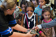 """Lissa Hilbert shows students the differences in between different types of turtles at Lorenzo De Zavala Environmental Science Academy in Grand Prairie, Texas on October 7, 2016. """"CREDIT: Cooper Neill for The Wall Street Journal""""<br /> PUBLICS"""