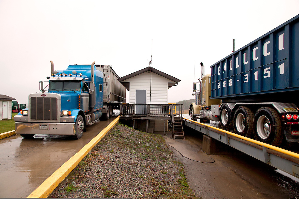 waste transfer trucks at weigh house of sanitary landfill