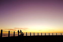 South Africa - Cape Town - 300520.  Two people enjoy the sunset at Sea Point during the lockdown period.  Picture: Ian Landsberg/African News Agency (ANA).