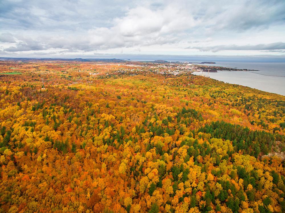 Aerial drone photo of fall color surrounding  Marquette, Michigan.