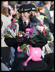 December 25, 2019, Sandringham, United Kingdom: Image licensed to i-Images Picture Agency. 25/12/2019. Sandringham, United Kingdom. A policewoman with flowers and gifts given to the Royal family after they left the Christmas Day church service at Sandringham in Norfolk, United Kingdom. (Credit Image: © Stephen Lock/i-Images via ZUMA Press)