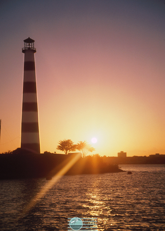 Lighthouse on the south shore of Clear Lake at the entrance to South Shore Harbour in League City, Texas, USA photographed at sunset.