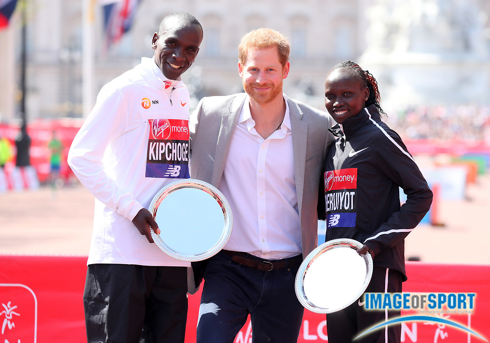 Eliud Kipchoge (KEN), left, and Vivian Cheruiyot (KEN), right, pose with Prince Harry after winning the men's and women's race in the London Marathon in London, Sunday, April 22, 2018. (Jiro Mochizuki/Image of Sport)