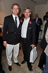 Left to right, JONATHAN COLEMAN and TIM GOSLING at a party to celebrate the publication of 'Garden' by Randle Siddeley held at Linley, 60 Pimlico Road, London on 24th May 2011.