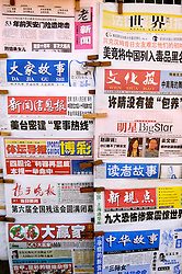 Many Chinese newspapers on sale in Shanghai