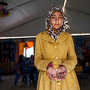 """Millions of people are still living far from home after fleeing the four-year war in Syria — refugee life is their new reality, filled with heartbreak and challenges.<br /> <br /> Some fled to refugee camps, and others now live in host communities in Syria's neighboring countries. Many had to run from their homes with only the few personal items they could carry.<br /> <br /> These items have become bittersweet symbols of home and hope — they connect them to the life they've loved and ache to regain one day.<br /> <br /> To shed light on the personal experiences in the midst of this crisis, we visited Syrians participating in our programs in Jordan and asked: What is the most important thing you brought with you? Produced with funds provide by Mercy Corps.<br /> <br /> Sajida, 14, and her family left their home in Daraa, Syria for the safety of Jordan two and a half years ago. She and her close friends exchanged necklaces.<br /> <br /> """"At the beginning of the war we didn't know what was going to happen, we thought we might get separated so we gave each other gifts to remember one another by."""" All of the other girls have remained in Syria. This necklace is from her best friend, Batool.<br /> <br /> Sajida participates in arts and crafts at school in this Mercy Corps extracurricular classroom in Zaatari camp for Syrian refugees, Jordan, May 2015."""