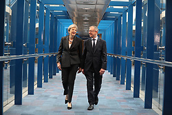 October 3, 2018 - Birmingham, West Midlands, UK - Birmingham, UK. Prime Minister THERESA MAY and her husband PHILIP MAY cross the bridge from the Hyatt Regency Hotel to the Conference Centre ahead of the Leaders' speech . Day 4 of the Conservative Party conference at the ICC in Birmingham  (Credit Image: © Joel Goodman/London News Pictures via ZUMA Wire)